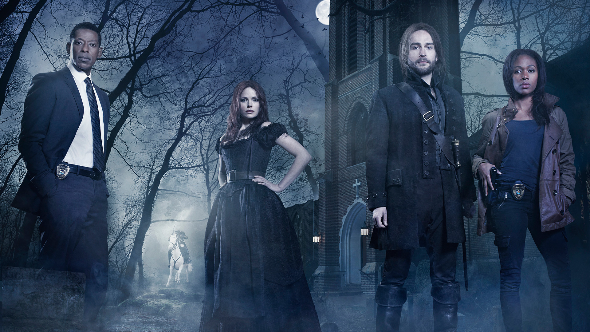 """SLEEPY HOLLOW: From co-creators/executive producers Alex Kurtzman and Roberto Orci comes the adventure thriller """"Sleepy Hollow."""" In this modern-day retelling of Washington Irving's classic, Ichabod Crane (Tom Mison, third from L) is resurrected and pulled two and a half centuries through time to find that the world is on the brink of destruction and that he is humanity's last hope, forcing him to team up with a contemporary police officer (Nicole Beharie, R) to unravel a mystery that dates back to the founding fathers. Also pictured (L-R): Orlando Jones and Katia Winter. Photo Credit: © 2013 Michael Lavine/Fox."""